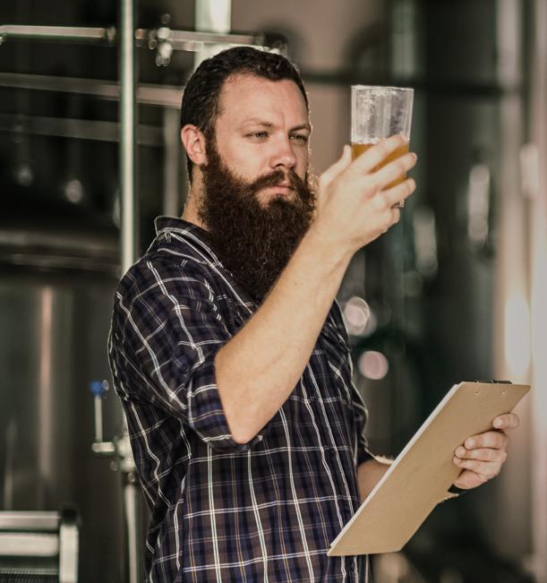 Man inspecting beer